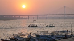 Pilgrims in boats at Sunset at Sangam,Allahabad,Kumbh Mela,India Stock Footage