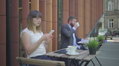 Businessman drinks coffe during work. Outdoor. Steadicam shot. Stock Footage