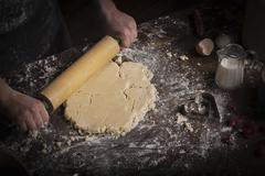 Valentine's Day baking, woman rolling out dough with a rolling pin. Stock Photos