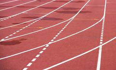 Red running athletic track, bad weather, wet Stock Photos
