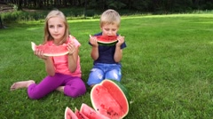 Kids eating watermelon outdoors Stock Footage