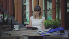 Businesswoman browsing tablet. Outdoor. Steadicam shot. Stock Footage