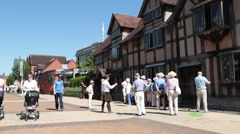 Tourists outside Shakespeare's birthplace Stock Footage
