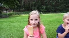 Kids eating icecream outdoors Stock Footage