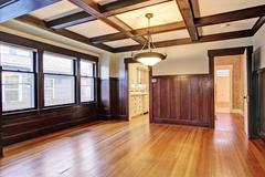 Empty room with wood paneled walls and coffered ceiling.American craftsman ho Stock Photos