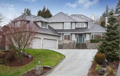 Luxury two level house with garage and driveway. Also nice landscape desing a Stock Photos