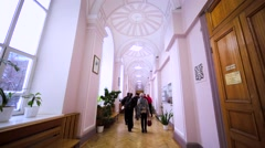Students walk along corrodor of Faculty of Journalism of Moscow State University Stock Footage