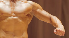 Powerful man with strong masculine arms and muscular torso, bodybuilding contest Stock Footage