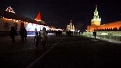 Red Square with walking people. Night view of the Saint Basil's Cathedral Stock Footage