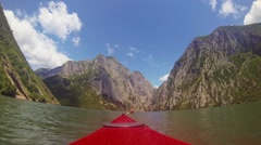 POV Paddling behind a Girl in Kajak through wild nature 60fps graded Stock Footage
