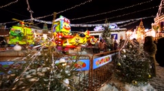 Children's carrousel on decorated Christmas fair on the Red Square. Evening. Stock Footage
