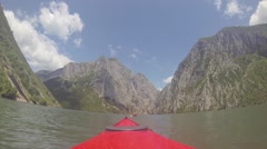 POV Paddling behind a Girl in Kajak through wild nature 60fps flat Stock Footage