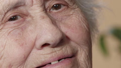 Wrinkled old woman face Stock Footage
