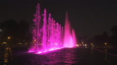 Purple lit  fountain on the magic water circuit in lima Stock Footage