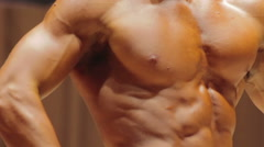 Perfect six-pack abs and muscular torso of strong bodybuilder, ideal masculinity Stock Footage