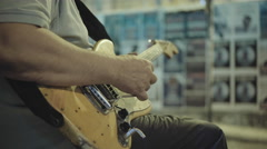 Street artist plays electric guitar live in busy city street at night Stock Footage