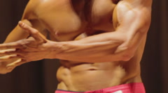 Annoyed bodybuilder disappointed with competition results, arguing with jury Stock Footage