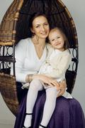 Young mother with daughter at luxury home interior vintage Stock Photos