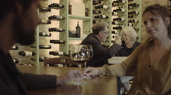 Senior couple on a date in crowded restaurant Stock Footage