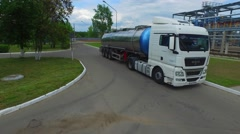 Powerful tank truck rides through the territory of modern chemical complex - stock footage