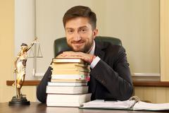 Successful lawyer in office sitting at desk Stock Photos