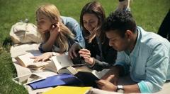 Closeup three students reading tutorial outdoors Stock Footage