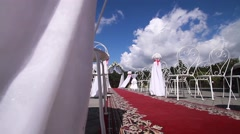 White design wedding ceremony, a red carpet. A bright Sunny day, blue sky. Stock Footage