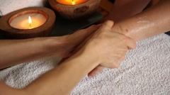 Young woman gets a hand massage in the spa salon. close-up of candles. masseur Stock Footage