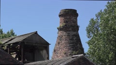 Industrial bottle kiln heritage architecture deep blue sky Stock Footage