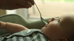 Baby eating from a spoon Stock Footage