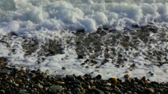 Seashores. pebble beach. waves and sea foam Stock Footage