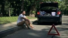 Handsome afro american male upset car is broken - stock footage