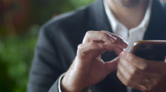 Businessman using mobile phone - dolly Stock Footage