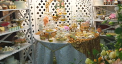 Stylish luxury decorated candy bar with frosting cake at the golden birthday Stock Footage