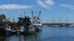 Fishing boats moored in Scarborough harbor Stock Footage