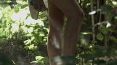 Mosquito repellent. Woman spraying insect repellent on skin outdoor in nature Stock Footage