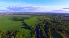 Drone flight over the farmland with irrigation channel at sunny day - stock footage