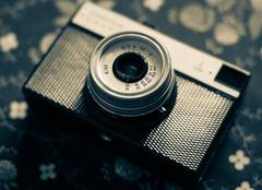 Old vintage camera on a  fabric background Stock Photos