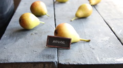 Inscription natural and Juicy flavorful pears Stock Footage