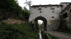 Beautiful tunnel  over mountain river in medieval town Stock Footage