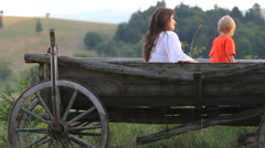 Mother and son in wooden cart, enjoy sunny whether - stock footage