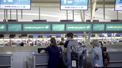 Checking in - travelers waiting at airport desk at JFK in 4K Stock Footage