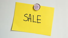 """Hands put note with word Sale after quastion """"Guess what?"""" on white board - stock footage"""