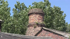 Industrial old heritage architecture moving trees bottle kiln Stock Footage