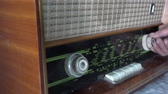 Searching stations on vintage radio Stock Footage