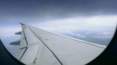 Airplane window seat view of wing - plane in flight in 1080 HD Stock Footage
