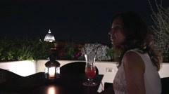 Single lady sightseeing Rome Vatican city from above terrace restaurant table 4K Stock Footage