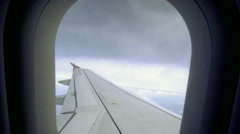 View out airplane window with clouds in sky in mid flight 1080 HD Stock Footage
