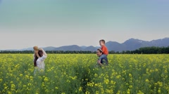 Father giving piggy ride to child and mother to teddy bear, cheerful family Stock Footage