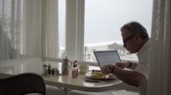 Man eating breakfast in Los Angeles restaurant interior 1080 HD Stock Footage